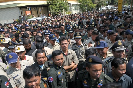 Hundreds of police, military police and RCAF soldiers on Sunday wait outside the Phnom Penh mansion of Choeung Sopheap, the owner of Pheapimex company and wife of CPP Senator Lao Meng Khin, to receive envelopes of money for the Chinese New Year. (Ben Woods/The Cambodia Daily)