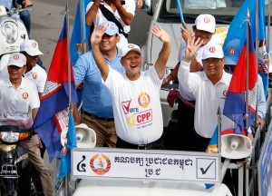 Hun Many, center, the youngest son of Prime Minister Hun Sen and a first-time CPP candidate for the National Assembly, leads a rally of about 10,000 CPP youth supporters through Phnom Penh in 2013. (Siv Channa)