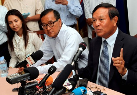 From left, Cambodia National Rescue Party President Sam Rainsy and CNRP Deputy President Kem Sokha hold a press conference on Saturday morning at the opposition's office in Phnom Penh's Meanchey district where they warned of possible electoral fraud during Sunday's vote. (Siv Channa)