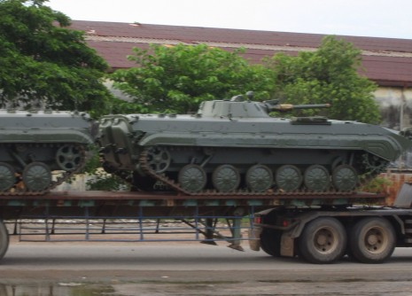 A truck transports tanks at the port in Sihanoukville yesterday. Officials said they would be used to ensure national security.