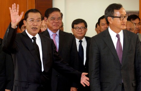 Prime Minister Hun Sen, left, and opposition CNRP leader Sam Rainsy, far right, attend the opening of negotiations in Phnom Penh on Monday, aimed at breaking the political stalemate over July's disputed national election. (Siv Channa)