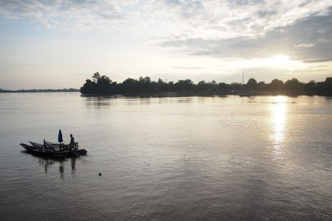 A ferryboat crosses the Hou Phapheng river, a channel of the Mekong River in Laos, near to where the Don Sahong hydropower dam is slated to be built despite protests from Cambodia that the project could seriously affect fisheries. (Nontarat Phaicharoen)