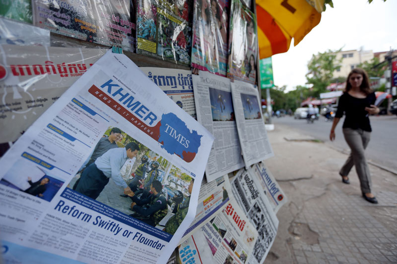 The second edition of the Khmer Times is displayed for sale at a newspaper stall along Street 51 in Phnom Penh on Monday. (Siv Channa)