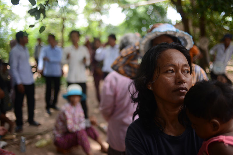 Lor Peang village representative Um Sophy, a mother of four, was sacked from her teaching job in 2009 for her activism. Police tried to arrest her on a court warrant Monday. (Lauren Crothers/The Cambodia Daily)