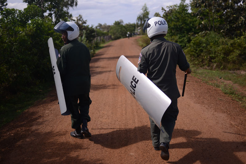 Police officials had been waiting around in the area since early morning and said their presence was to ensure that there were no confrontations. (Lauren Crothers/The Cambodia Daily)
