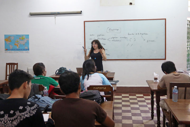 Linguist and professor Helene de Penanros teaches first-year students enrolled in the international bachelor's degree program in the humanities at the Royal University of Fine Arts. (Siv Channa)
