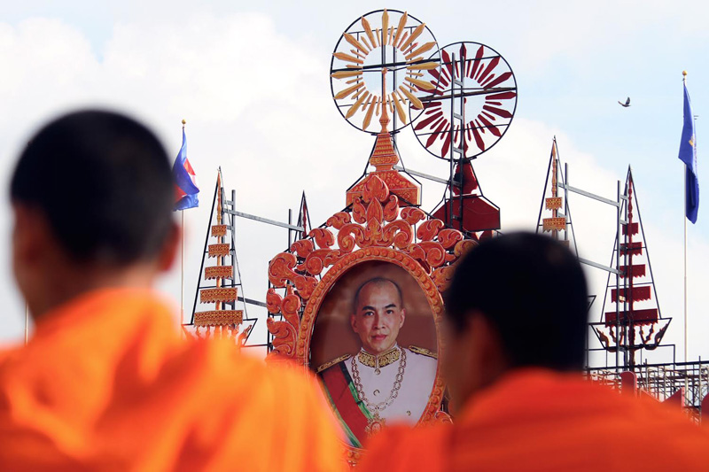 Monks take part in a procession in front of the Royal Palace in Phnom Penh on Tuesday on the first day of a three-day ceremony to mark 10 years since King Norodom Sihamoni ascended the throne. (Siv Channa/The Cambodia Daily)