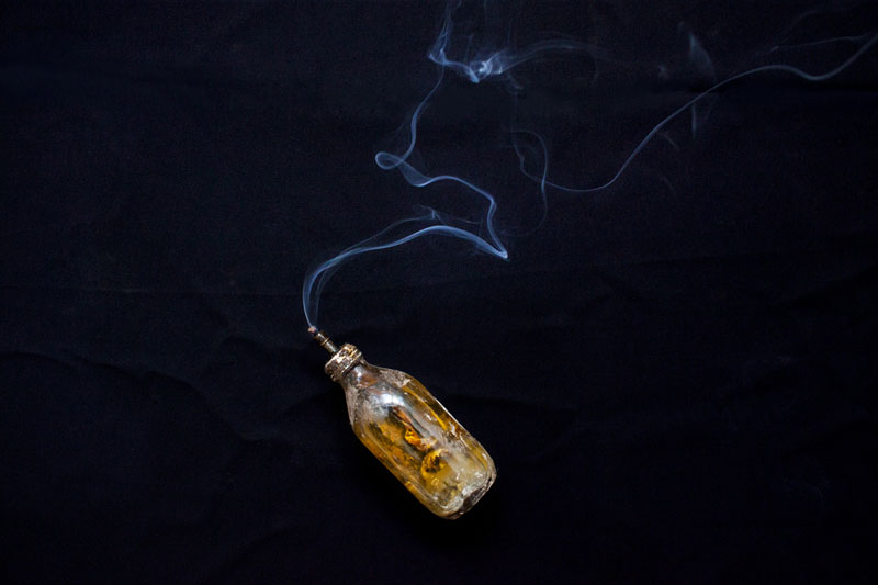 'Fish Oil and Smoke' by Kim Hak. The bottle, once owned by Gnet Yorn, was used to provide light, as there was no electricity in the countryside under the Khmer Rouge. (Kim Hak)