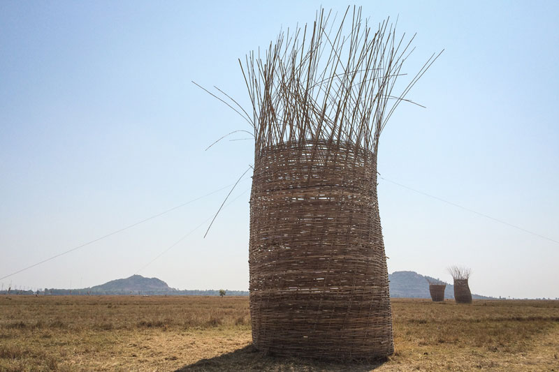 A bamboo sculpture erected for the 'Rice, Life and Culture' festival stands in a field in Banteay Meanchey province's Preah Netr Preah district on Friday. (Emily Townsend/The Cambodia Daily)