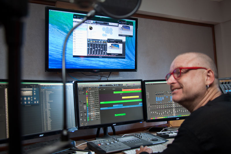 Steve Bloxham, a sound engineer at Siem Reap's 60 Road Studios, sits at the production desk during the studio's opening on Thursday. (Lim Sokchanlina)