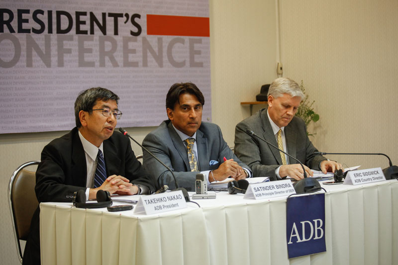 Asian Development Bank President Takehiko Nakao, left, speaks during a press conference at the Bank's office in Phnom Penh on Tuesday. (Siv Channa/The Cambodia Daily)