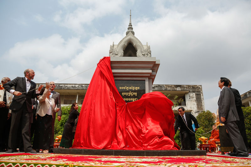 A stupa inscribed with the words 'Never will we forget the crimes committed during the Democratic Kampuchea regime' is unveiled Thursday at Phnom Penh's Tuol Sleng Genocide Museum. (Siv Channa/The Cambodia Daily)