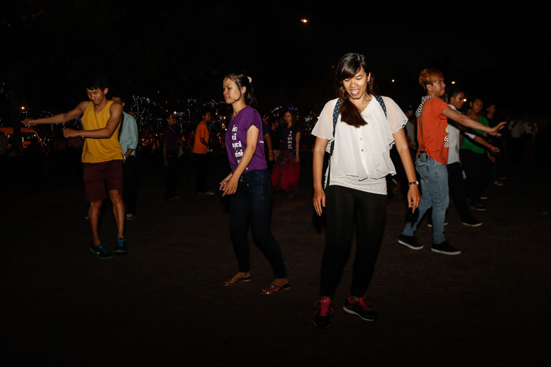 Members of a flash mob dance to raise awareness for women's rights at Wat Botum park in Phnom Penh on Thursday. (Siv Channa/The Cambodia Daily )