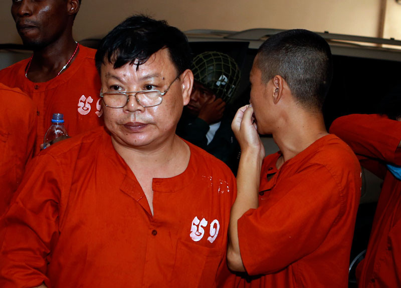 Xie Tao Sheng leaves the Phnom Penh Municipal Court on Monday after he and two other Chinese nationals were tried for attempting to traffic four Cambodian teenagers to China. (Siv Channa/The Cambodia Daily)