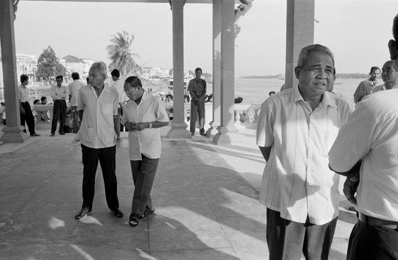 Chea Sim, right, stands in a pavilion on Phnom Penh's riverside prior to a ceremony to inaugurate the Preah Ang Dangker shrine on June 11, 1991. (John Vink)