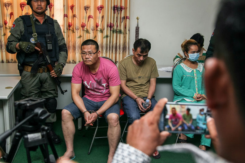 Drug trafficking suspects Ly Yong, left, Deng Yuan Ping, center, and Phal Rany sit at a press conference at the National Police headquarters in Phnom Penh on Saturday.