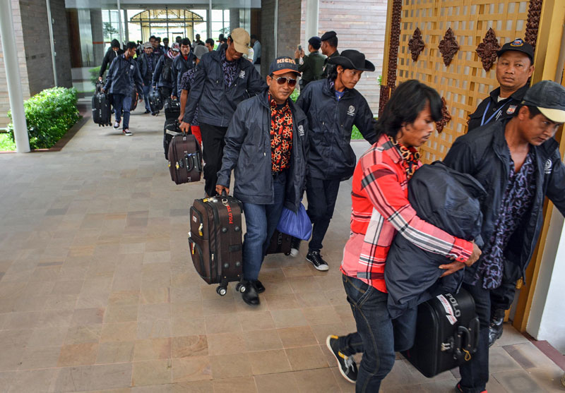 Fishermen who were rescued from forced labor in Indonesia leave Phnom Penh International Airport on Tuesday. (Alex Consiglio/The Cambodia Daily)