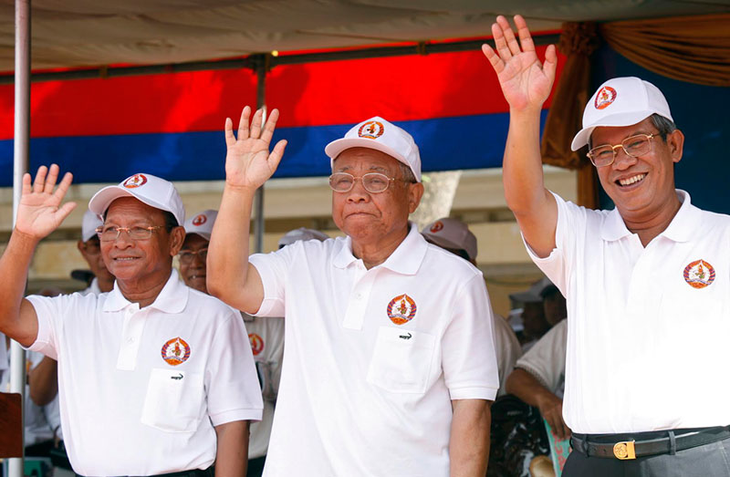 Late CPP President Chea Sim, center, stands between National Assembly President Heng Samrin left, and Prime Minister Hun Sen during an election rally in Phnom Penh in June 2008. (Reuters)