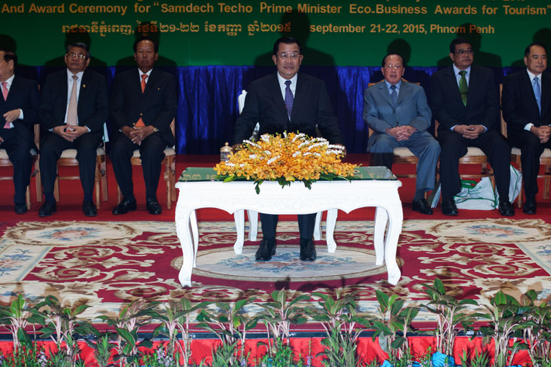 Prime Minister Hun Sen sits on stage during a conference on tourism at the Sokha Hotel in Phnom Penh on Tuesday. (Jens Welding Ollgaard/The Cambodia Daily)