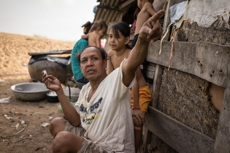 Mr Chantha sits with his family on Tuesday. (Ben Woods/The Cambodia Daily)