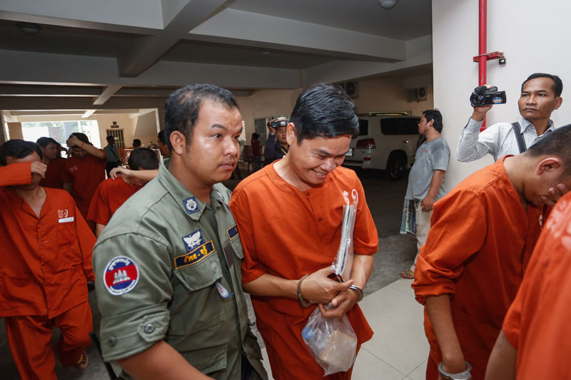 Former orphanage director Hang Vibol leaves the Phnom Penh Municipal Court on Tuesday after the first day of his trial on charges of sexually abusing children under his care. (Siv Channa/The Cambodia Daily)