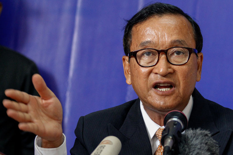 Opposition leader Sam Rainsy speaks during a press conference in 2013. (Siv Channa/The Cambodia Daily)