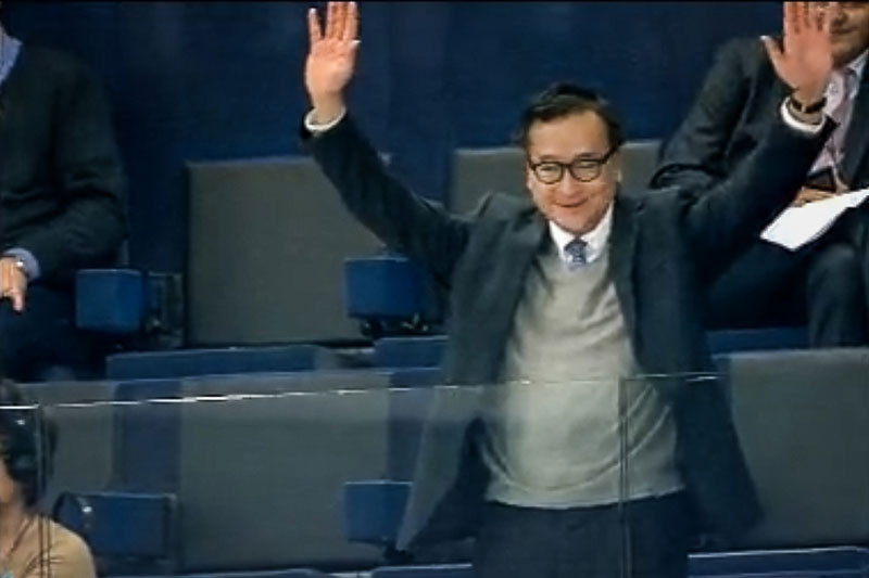 Opposition leader Sam Rainsy greets the European Parliament in Strasbourg, France, after it passed a resolution on Cambodia on Thursday, in this still image from a live broadcast