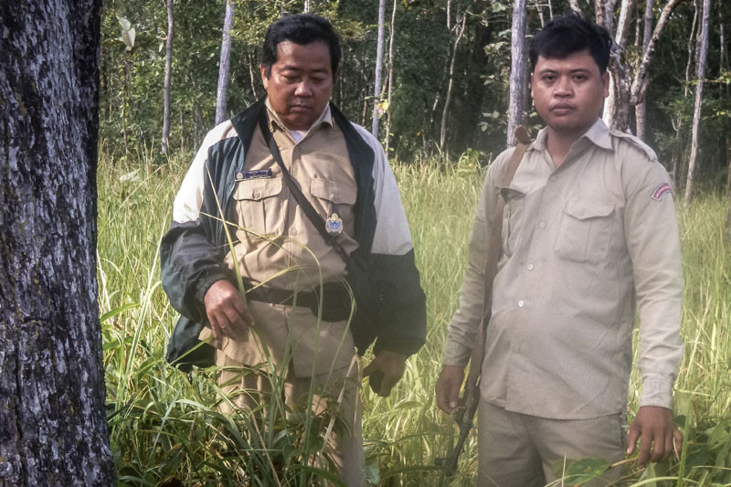 Forestry Administration ranger Seang Narong, left, and police officer Sap Yous, who were both shot dead while patrolling for illegal loggers in 2015, in an undated photo taken in the Preah Vihear Protected Forest (Wildlife Conservation Society)
