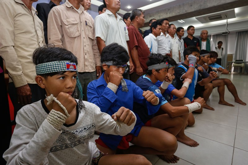 Young practitioners of the Cambodian martial art bokator pose during a seminar at the offices of the National Olympic Committee of Cambodia in Phnom Penh on Tuesday. (Siv Channa/The Cambodia Daily)
