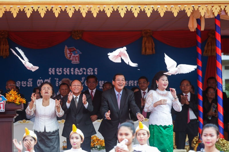 National Assembly President Heng Samrin, left, and Prime Minister Hun Sen, along with their wives, release doves at the CPP's headquarters in Phnom Penh in January during a ceremony to mark 37 years since the overthrow of Pol Pot. (Siv Channa/The Cambodia Daily)
