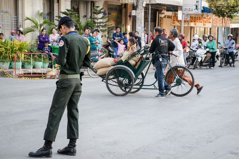 Crew members push a cyclo onto the set of 'First They Killed My Father' in Battambang City this week. (Geordie Hay)