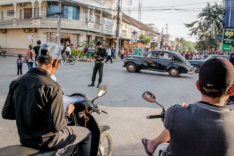 Antique cars are driven near the set of 'First They KIlled My Father' in Battambang City this week. (Geordie Hay)