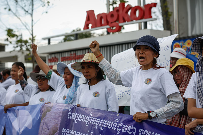 Anti-dam activists protest outside the headquarters of Angkor Beer in Phnom Penh on Friday. (Siv Channa/The Cambodia Daily)