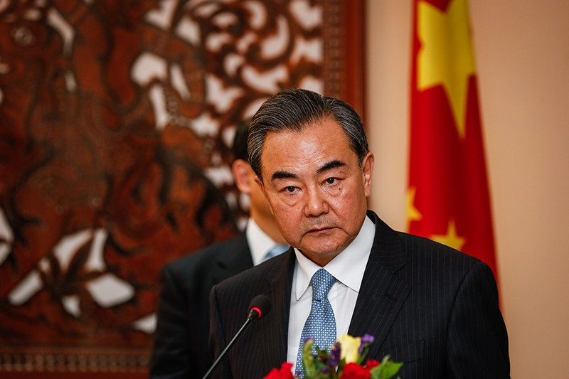 Chinese Foreign Minister Wang Yi speaks at a press conference in Phnom Penh on Friday. (Siv Channa/The Cambodia Daily)