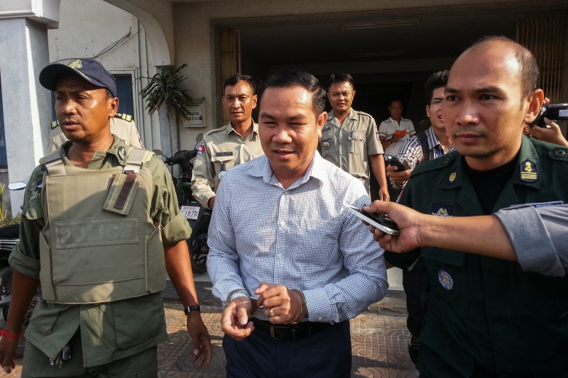 CNRP lawmaker Um Sam An is escorted from the Interior Ministry in Phnom Penh on Monday after being arrested in Siem Reap City shortly after midnight. (Thmey Thmey)