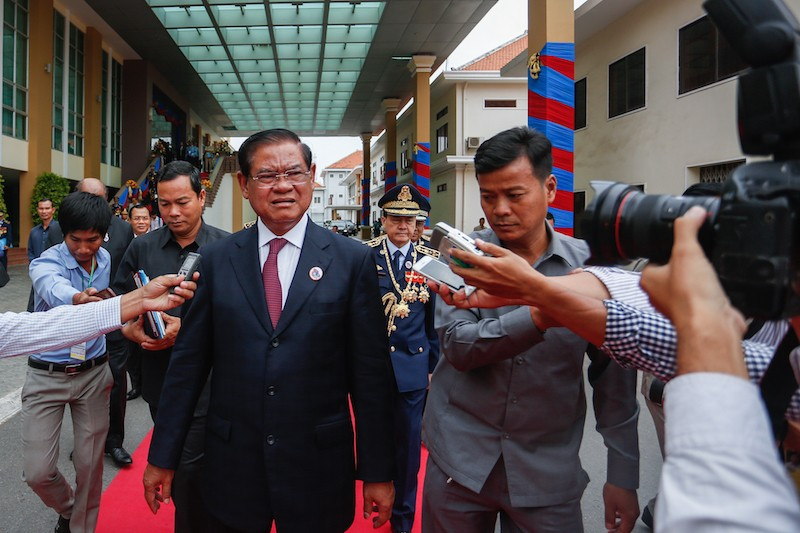Interior Minister Sar Kheng speaks to reporters as he leaves a ceremony marking the 71st anniversary of the national police in Phnom Penh in May. (Siv Channa/The Cambodia Daily)