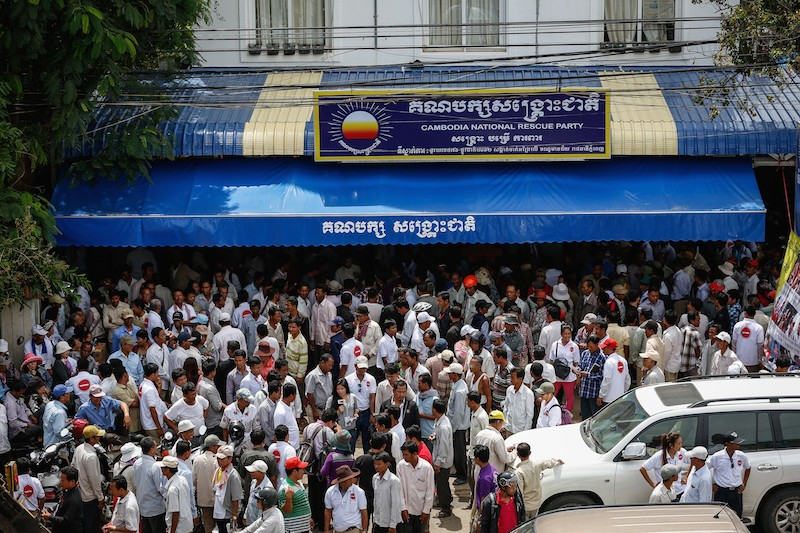 Opposition supporters gather outside the CNRP's headquarters in Phnom Penh in May. (Siv Channa/The Cambodia Daily)