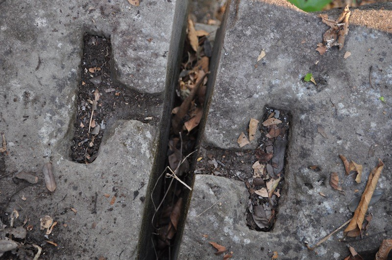 Cavities that were carved into stones and fit with steel joints during the Angkorian era (Mitch Hendrickson)