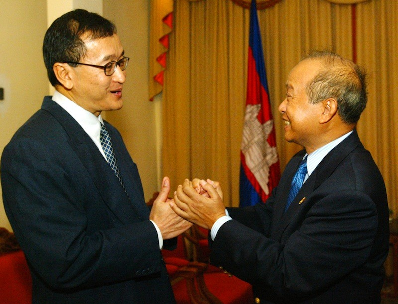 Sam Rainsy and Prince Norodom Ranariddh greet each other at the National Assembly in February 2006, a month before the prince resigned amid a sex scandal. (Reuters)