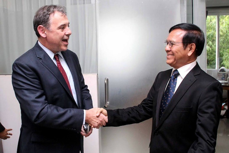 US Ambassador William Heidt greets deputy opposition leader Kem Sokha at the CNRP's headquarters in Phnom Penh on Friday, in a photograph posted to Mr. Sokha's Facebook page.