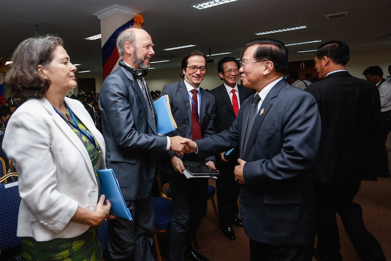 Germany's outgoing ambassador, Joachim Baron von Marschall, center left, greets CPP lawmaker Chheang Vun at a workshop at the National Assembly in November. (Siv Channa/The Cambodia Daily)