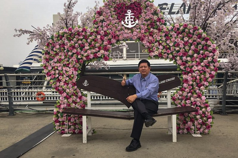 Education Ministry official Kry Seang Long poses beneath a trellis while in Seoul for the 2016 Asean+3 HRD Forum in May, in a photograph posted to Mr. Seang Long's Facebook account.