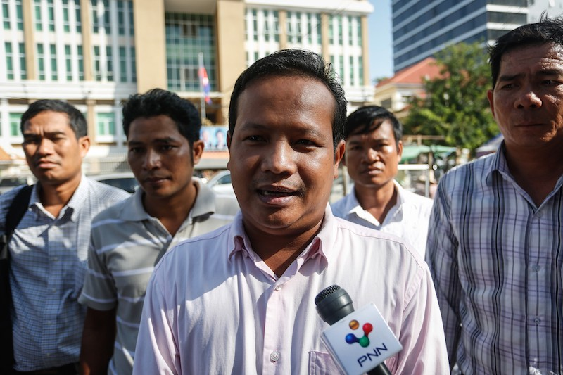 Pav Sina speaks to reporters outside the Phnom Penh Municipal Court on Thursday morning. (Siv Channa/The Cambodia Daily)
