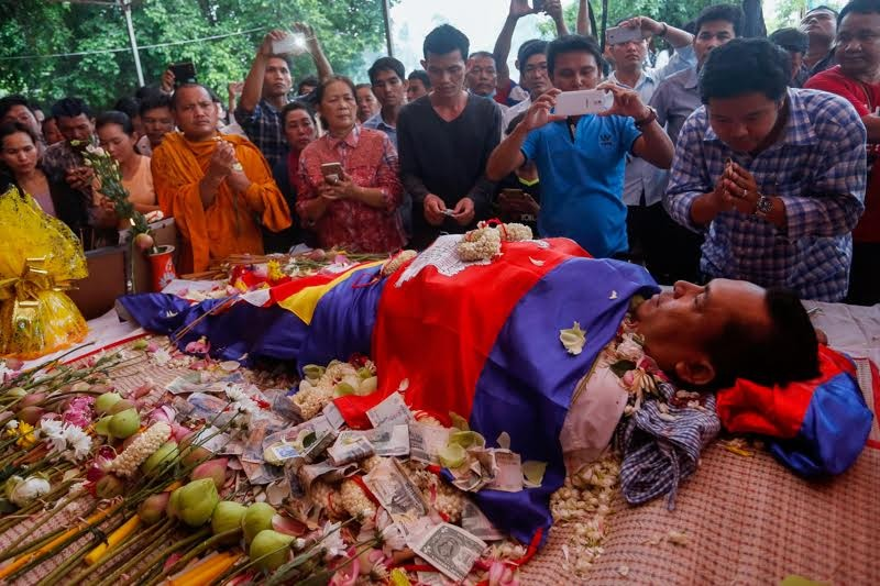 Kem Ley's body is laid at the Wat Chas pagoda in Phnom Penh after he was shot dead at a gas station earlier in the day. (Siv Channa/The Cambodia Daily)