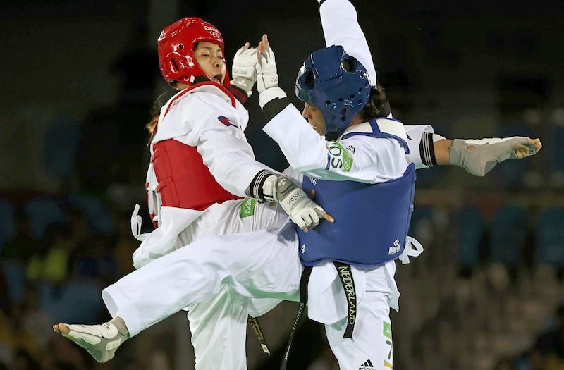 Cambodian taekwondo star Sorn Seavmey, left, fights Reshmie Oogink from the Netherlands in the preliminary round of the women's over 67 kg competition at the Olympic Games in Rio de Janeiro on Saturday. (Reuters)