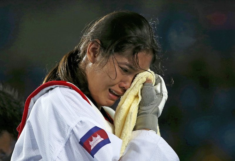 Cambodian taekwondo star Sorn Seavmey, left, cries after losing to Reshmie Oogink from the Netherlands in the preliminary round of the women's over 67 kg competition at the Olympic Games in Rio de Janeiro on Saturday. (Reuters)