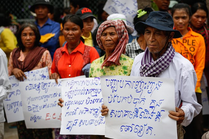 Villagers from Kompong Speu province protest in Phnom Penh on Thursday calling for the NGO Equitable Cambodia to drop a complaint filed against the Phnom Penh Sugar Company on their behalf. (Siv Channa/The Cambodia Daily)