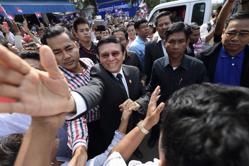 CNRP Vice President Kem Sokha greets supporters in front of the party's Phnom Penh headquarters in October. (Satoshi Takahashi)