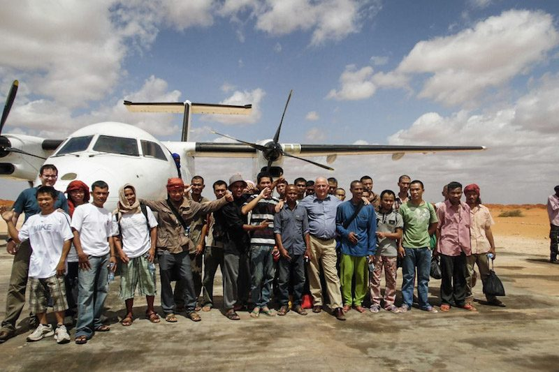 Former captives released by Somali pirates pose on Sunday in front of the airplane that flew them out of Somalia and to Nairobi, where they will depart for their home countries. (Hostage Support Partners)