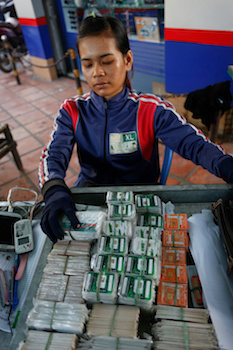 A vendor sells packets of SIM cards in a stall along Sothearos Boulevard in Phnom Penh on Tuesday. (Siv Channa/ The Cambodia Daily)